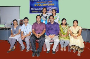 Quiz Master and Principal with winners